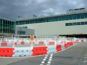 Water filled barriers c/w mesh fence panels