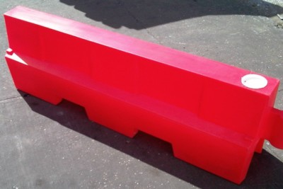 Close up image of a plastic EVO Road Barrier from Maltaward