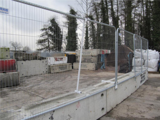 Steel fencing used in combination with concrete barriers for additional security